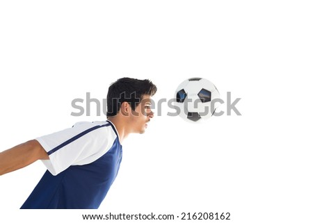 Side view of football player playing over white background