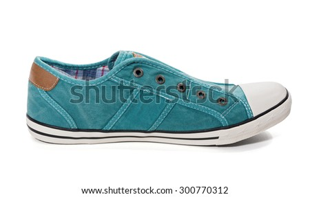 Side view of  green sneakers on white background - stock photo