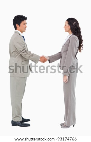 Side view of hand shaking trading partners against a white background