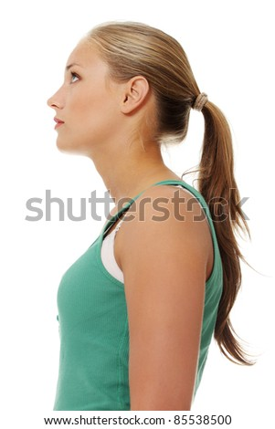 Side view of happy attractive female looking up. Isolated on white background. - stock photo
