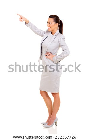 side view of happy businesswoman pointing up on white background - stock photo
