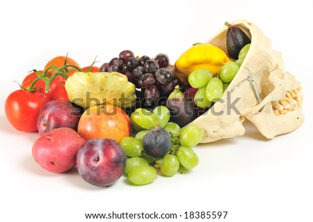 Side view of human skull overflowing with fruits and vegetables.