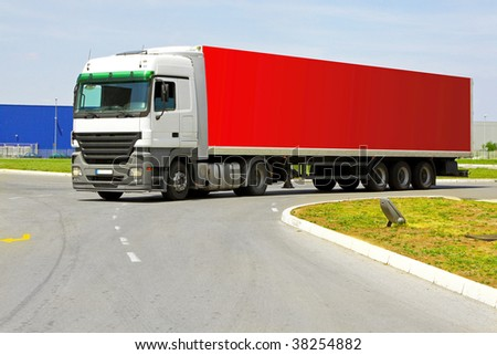 Side view of long red semi lorry