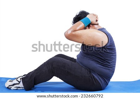 Side view of man doing workout to lose weight in studio, isolated over white - stock photo