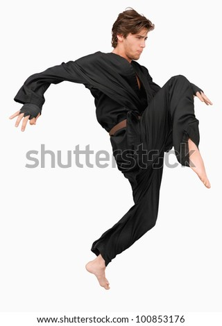 Side view of martial arts fighter attacking with his knee against a white background - stock photo