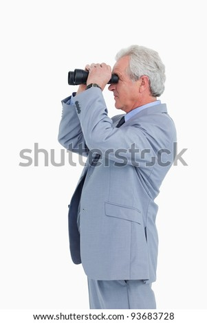 Side view of mature tradesman looking through spy glass against a white background - stock photo