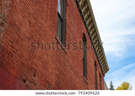 Side View Of Old Brick Building With Windows At Daytime