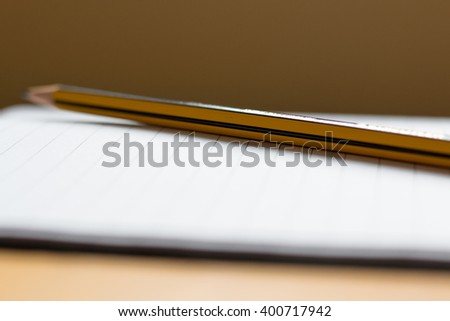 Side view of pencil on page