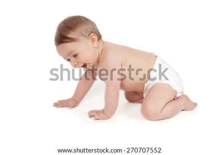 Side view of pretty smiling crawling baby - stock photo