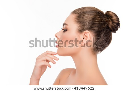 Side view of pretty woman touching chin on white background - stock photo