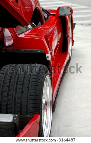 side view of red exotic race car - stock photo