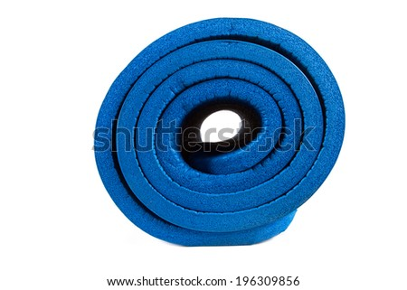 Side view of rolled blue yoga mat, isolated on white background. - stock photo