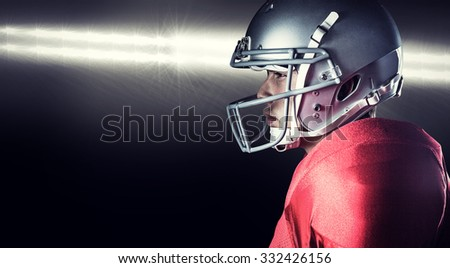 Side view of serious sportsman standing against spotlight