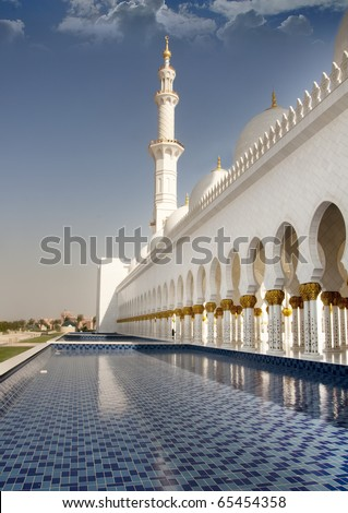 Side view of Sheikh Zayed mosque or grand mosque in Abu Dhabi, this is the side walk way and corridor view of the third biggest mosque in the world. - stock photo