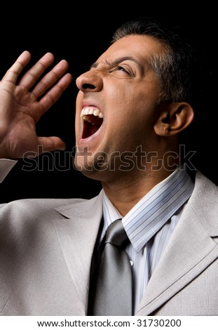 side view of shouting adult executive looking up - stock photo