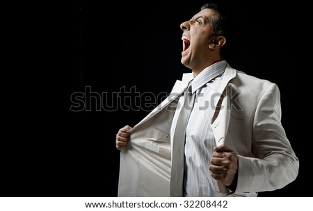 side view of shouting manager holding his coat - stock photo