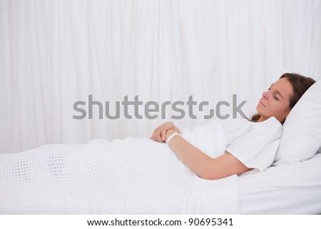Side view of sleeping bedridden patient - stock photo