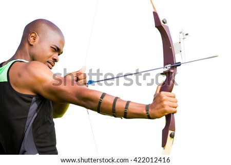 Side view of sportsman practising archery