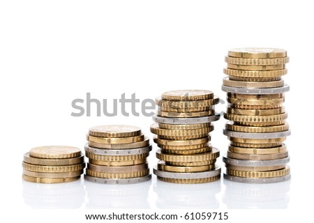 Side view of stacks of coins increasing in height, on white studio background - stock photo