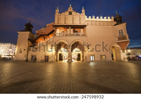 Side view of the Cloth Hall (Polish: Sukiennice) on the Main Market Square in the Old Town of Krakow in Poland. - stock photo