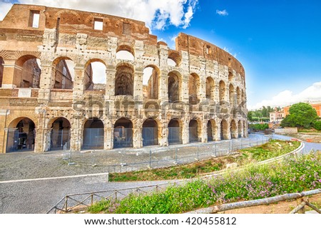 Side view of the Colosseo, coliseum, Flavian Amphitheatre, the largest amphitheater in the world and one of the symbols of Italy. Symbol of Rome, located in historical center, Unesco Heritage Site. - stock photo