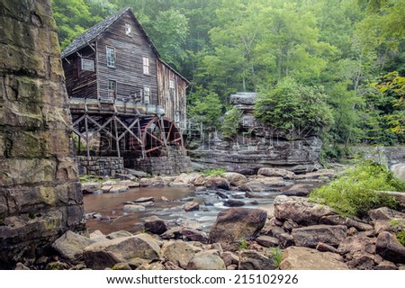 Side view of the Old Grist Mill taken from under the bridge at Babcock State Park, WV - stock photo