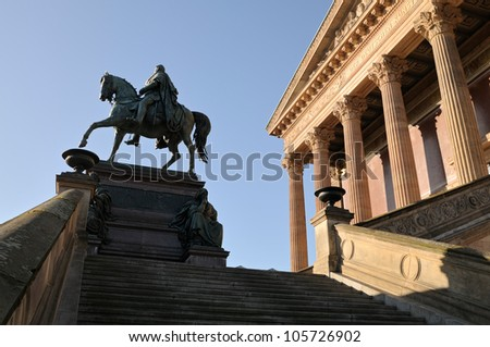 Side view of the Old National Gallery Berlin (Established 1861). It is a popular sight on Berlin's Museum Island. In front of the building is a bronze equestrian statue of Frederick William IV (1886)