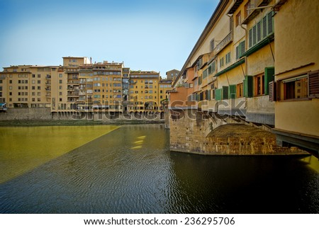 Side view of the Ponte Vecchio Bridge in Florence - stock photo