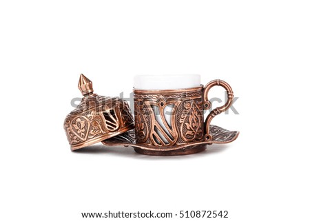 Side view of traditional cup of Turkish coffee, isolated on white background.