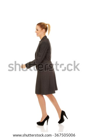 Side view of walking business woman - stock photo