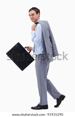 Side view of walking businessman with suitcase against a white background - stock photo