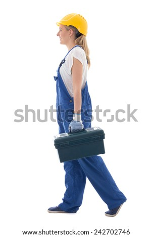 side view of walking woman in blue builder uniform with toolbox isolated on white background - stock photo