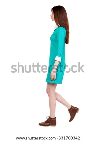 side view of walking  woman in dress. beautiful girl in motion.  backside view of person.  Rear view people collection. Isolated over white background. Girl in retro dress goes from left to right. - stock photo