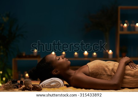 Side view of woman having aromatherapy treatment in spa salon - stock photo