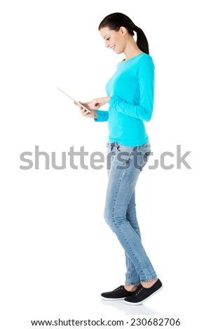 Side view of woman using tablet. - stock photo