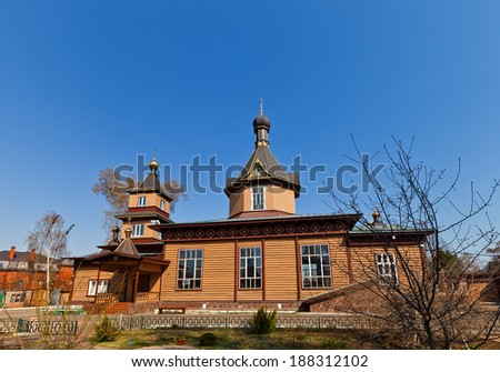 Side view of wooden orthodox church of Saints Peter and Paul (circa 1903). Malakhovka settlement, Moscow region, Russia. Architect Schusev A.