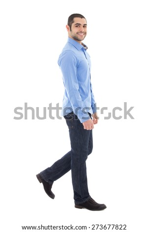 side view of young arabic bearded business man in blue shirt walking isolated on white background