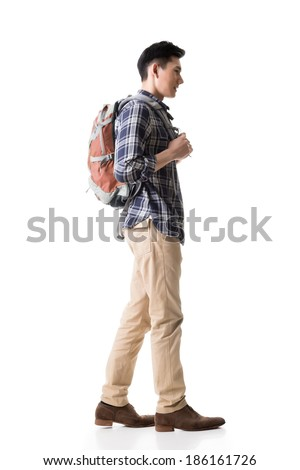 Side view of young Asian backpacker, full length portrait isolated on white background. - stock photo