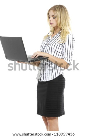 Side view of young blonde business woman standing using laptop - stock photo