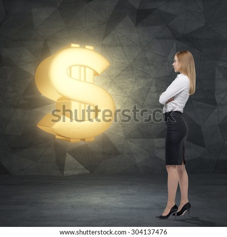 Side view of young business lady who is looking at the huge golden dollar sign. Contemporary background. - stock photo