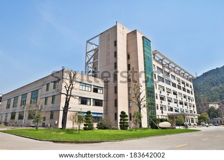 Side view on the office building with parking lot  - stock photo