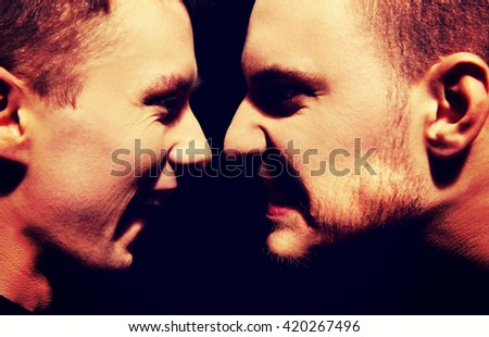 Side view on two screaming men  - stock photo