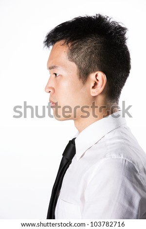 Side view portrait of a Happy Asian business man.