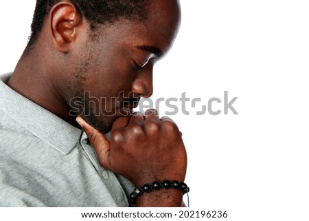 Side view portrait of a pensive african man over white background - stock photo