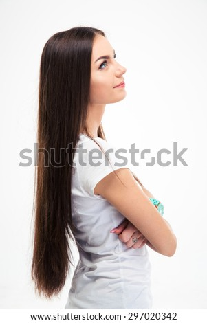 Side view portrait of a pensive young woman looking up isolated on a white background - stock photo