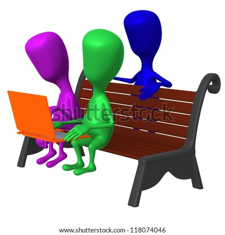 Side view puppet watching interesting movie on laptop - stock photo