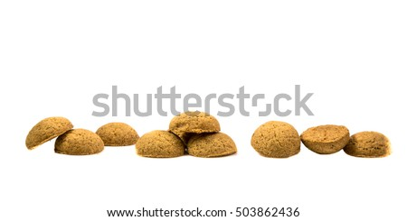Side view  Row of Pepernoten cookies as Sinterklaas decoration on white background for dutch sinterklaasfeest holiday event on december 5th