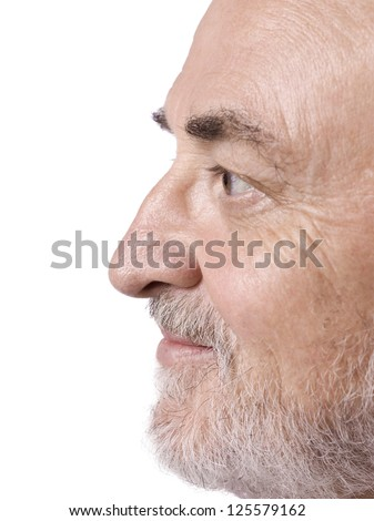 Side view shot of an old man's face isolated in a white background - stock photo