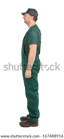 Side view. Worker in green overalls. Isolated on a white background - stock photo