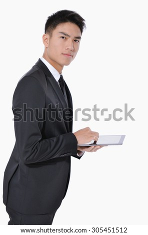 Side view young businessman Using Digital Tablet Isolated   - stock photo